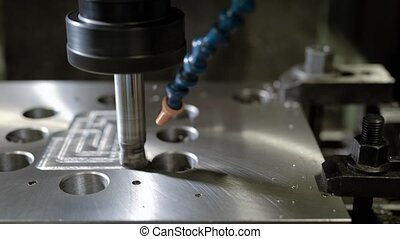 CNC milling machine in action, cutting metal piece. Milling...