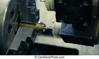 CNC milling machine makes some steel part - Close up of CNC...