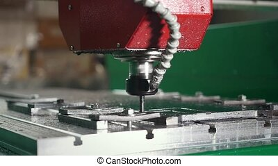 CNC milling or drilling machine, slow-motion, close up