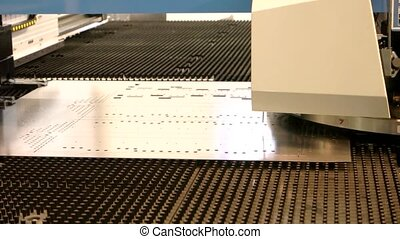 Cnc punching machine working. Steel sheet with holes. ...