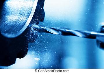 CNC turning, drilling and boring machine at work close-up....