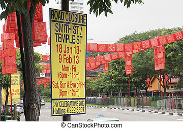 CNY celebration - road sign with closing cars traffic ...
