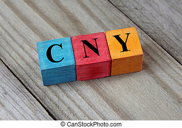 CNY (Chinese Yuan) sign on colorful wooden cubes