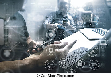 Co worker Designer hand using mobile payments online shopping, omni channel, in modern office wooden desk, icons graphic interface screen, eyeglass, filter