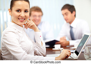 Co-worker - Portrait of a cheerful businesswoman looking at ...