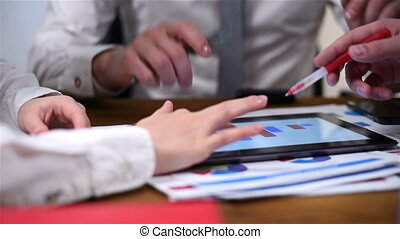 Co Worker Using Tablet - Three Businesspeople Using Tablet...