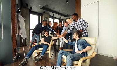 Co-workers are celebrating successful contract of the firm....