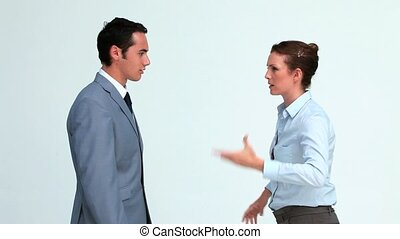Co-workers arguing in a studio