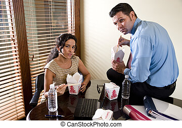 Co-workers in office eating Chinese take-out food - Office ...