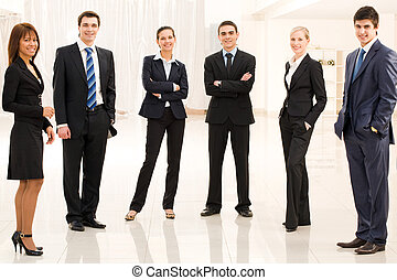 Co-workers - Portrait of confident business group standing...