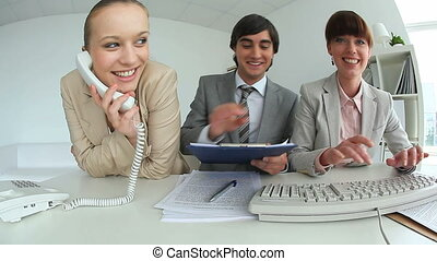 Co-workers - Time lapse video of three co-workers working...