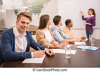 Co-working - Confident business woman in meeting at office ...