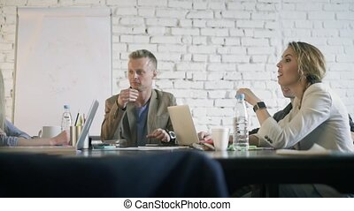 Co-working prosses. Business partners are discuss a project...