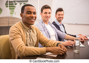 Co-working - Teamwork concept. Young people are sitting in...