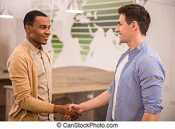 Co-working - Handshakes of two international business men in...