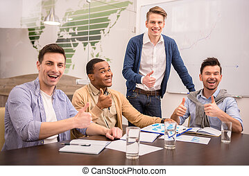 Co-working - Teamwork concept. Young business partners are...