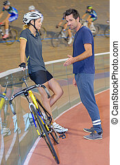 Coach advising cyclist