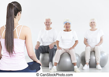 coach and elderly people breathing