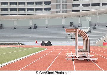Coach and reserve benches in soccer stadium side view
