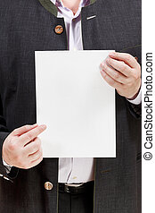 coach holds blank sheet of paper in hands