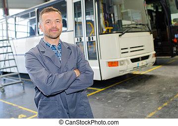 coach mechanic posing