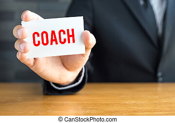 Coach, message on white card and hold by
