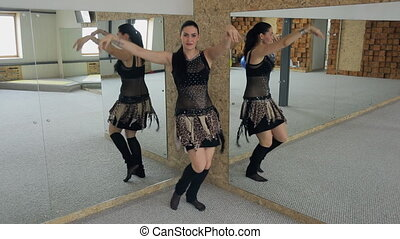 Coach on belly dance in mirror performs shaking, wave, eight hips.