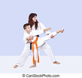 Coach teaches the athlete to hit a kick