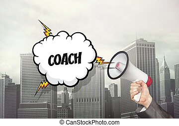 Coach text on speech bubble and businessman hand holding megaphone