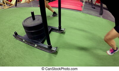Coach trained to woman pushing sled in fitness gym 4k - Low ...