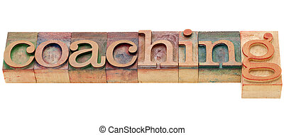 coaching word - coaching - isolated word in vintage wood...