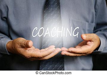 Coaching word on hand, businessman