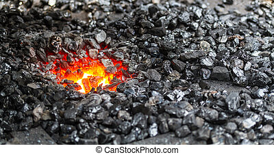 Coal and fire of a blacksmith's smithy