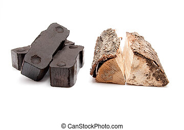 coal briquettes and pieces of firewood isolated on white background