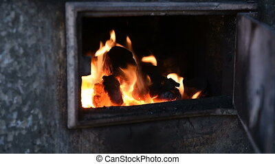 coal burns in the old Russian stone furnace heating house