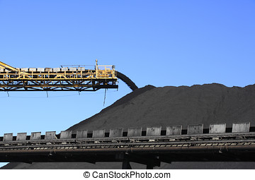 Coal Conveyor Belt - a large yellow conveyor belt carrying...