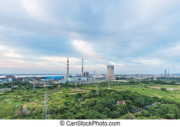 coal-fired power plant at dusk