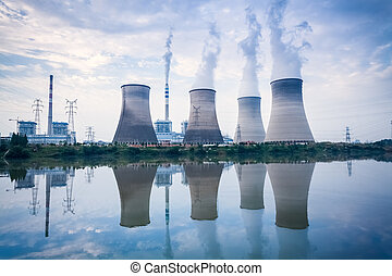 coal-fired power plant , cooling towers and river surface...