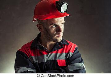 Coal miner looking away - Portrait of serious coal miner...