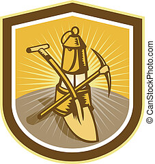 Illustration of a coal miner pick axe and shovel crossed with lamp set inside shield crest shape done in retro woodcut style.