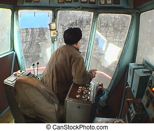 Coal mining. - Booth of the excavator. Coal loading.