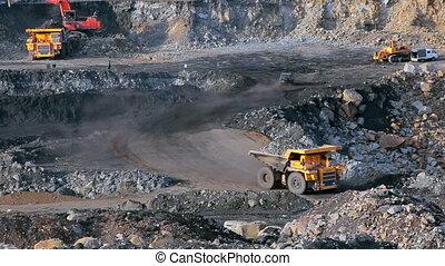 Coal mining in quarry, panorama yellow dump truck carries coal