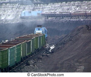 Coal mining. - Coal wagons on railway tracks.