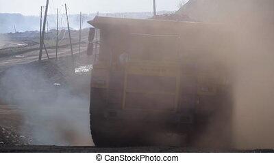 Coal mining. Yellow mining truck. - Coal mining. Yellow...