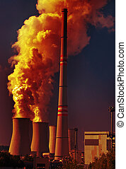 Power plant with dramatic clouds of smoke pollution
