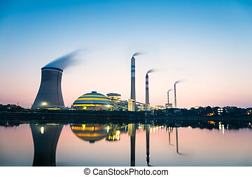 coal-fired power plant in nightfall , industrial landscape