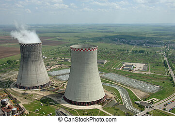 Coal power plant polluting the planet, several thin and...