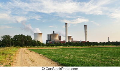 Coal Power Station And Dirt Road - Timelapse sequence of a...