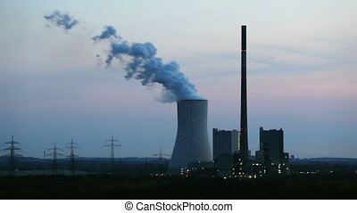 Coal Power Station At Night - Slow time lapse sequence of a...