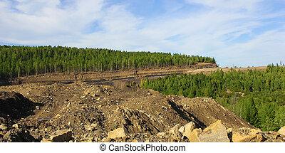 coal strip mine in South Yakutia against the blue sky